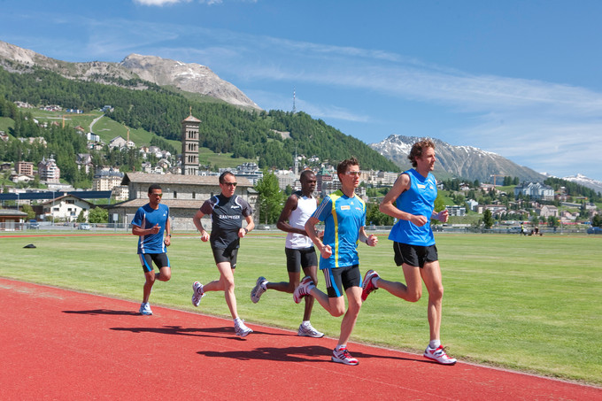This is a color photo of athletes running at an athletic training camp in the Swiss Alps.