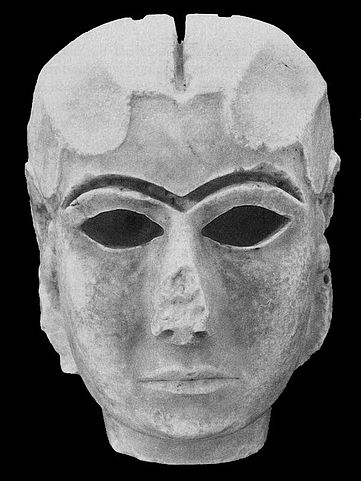 Depiction of an Uruk face mask with eyeholes.