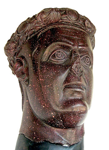 This is a photo of the Portrait Bust of Galerius. This bust from the emperor's palace features a face that is largely naturalistic with large expressive eyes and eyebrows, similar to those on the group portrait of the Tetrarchs, that lean toward abstraction.