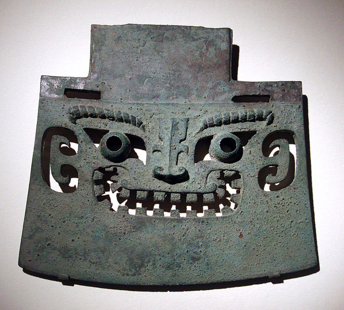 This axe is decorated with a face.
