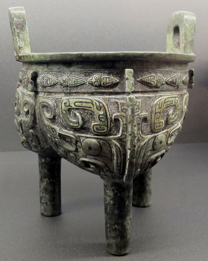 This three-legged vessel is intricately decorated.
