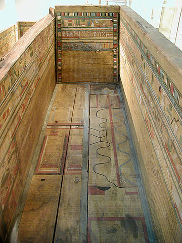 Photograph of a coffin decorated with maps.