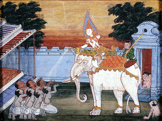 A decorated man sits on top of the while elephant, pouring something from a bottle into the hands of men on the ground, who are kneeling before him. Another man, presumably a servant figure, sits on the rear of the elephant.