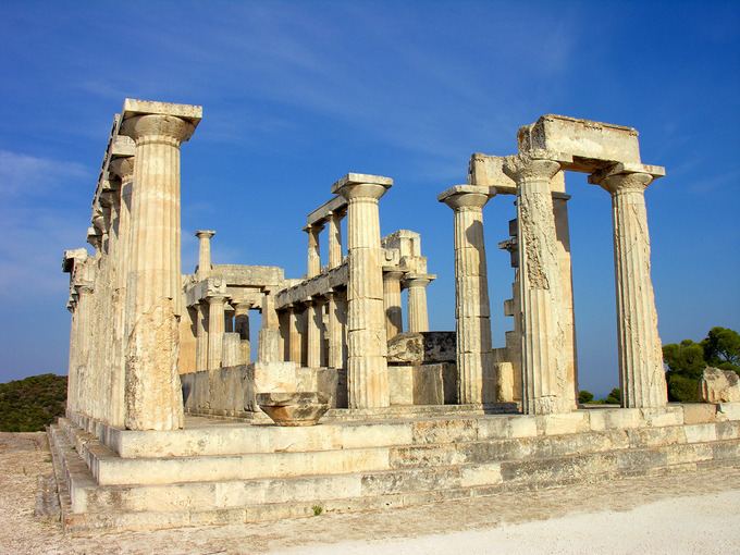 This is a photograph of the Temple of Aphaia at Aegina. It shows the remaining stepped foundation and columns of the structure.