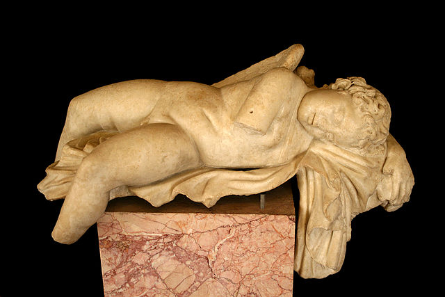 Sculpture depicts a nude Eros sleeping on his back.