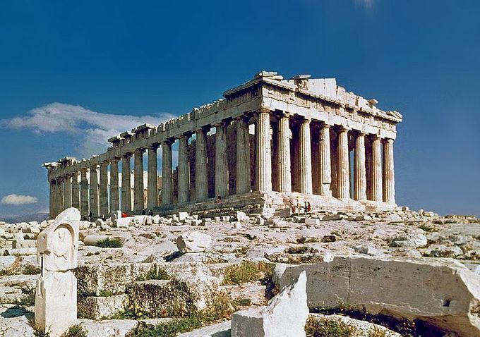 This is a current-day photo of the Parthenon, a temple with Ionic architectural features. It has eight columns in the front and seventeen on the sides.