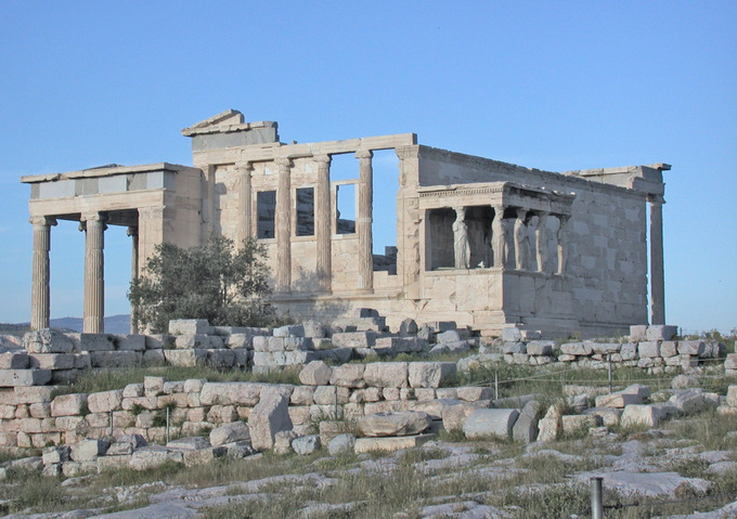 This is a current-day photo of the ruins of the Erechtheion in the Acropolis at Athens, showing Ionic columns.