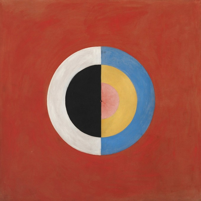 An abstract painting of a segmented bisected circle. One side is black and white. The other is multi-colored.