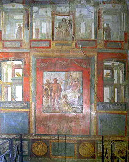 This photo shows a Fourth- Style wall fresco in the Ixion Room of the House of the Vettii.