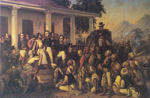Prince Diponegoro and Lieutenant General Hendrik Merkus de Kock stand in front of a colonial mansion. Surrounding them are officers. Javanese soldiers kneel on the ground before them.