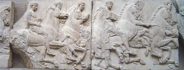 Photo of a frieze depicting a procession of men on horses.