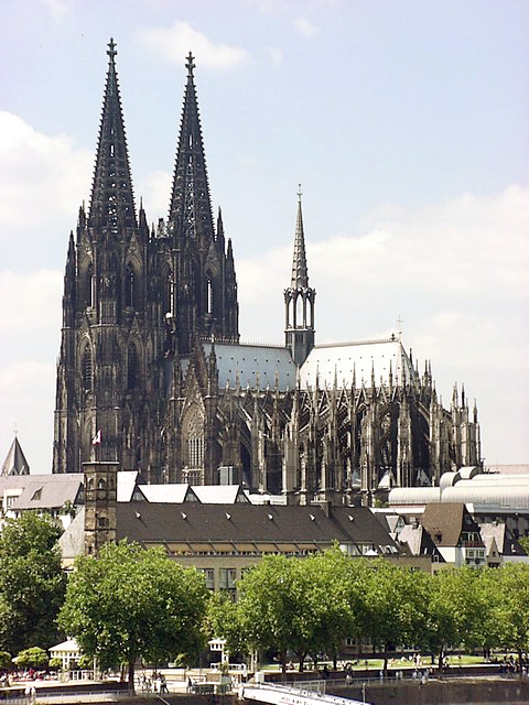 Exterior view of the Cologne Cathedral with the two spires clearly visible.