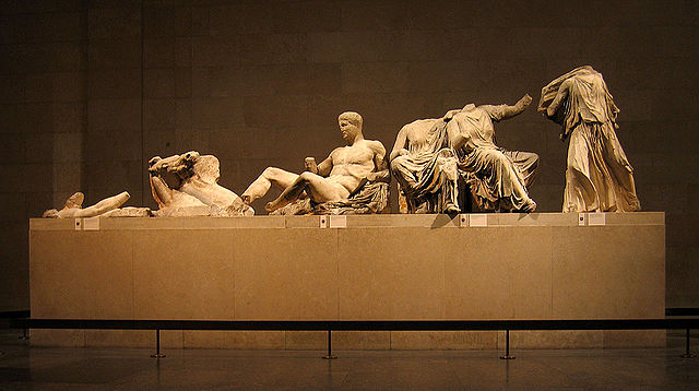 Photo of the remaining portions of a sculpture depicting the gods' reactions to the birth of Athena.
