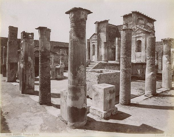 This is a black and white photo of the ruins of the Temple of Isis. The temple's design combines Roman, Greek, and Egyptian architectural elements.