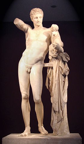 Photo depicts the marble statue of the nude Hermés, holding an infant.
