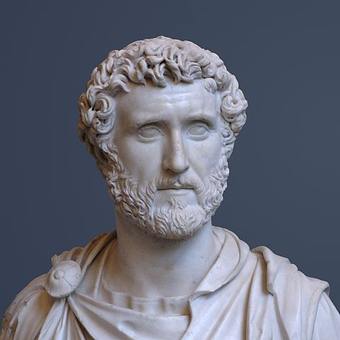 This photo shows a bust of Antoninus Pius. He has a hairstyle and beard that resemble his predecessor Hadrian.