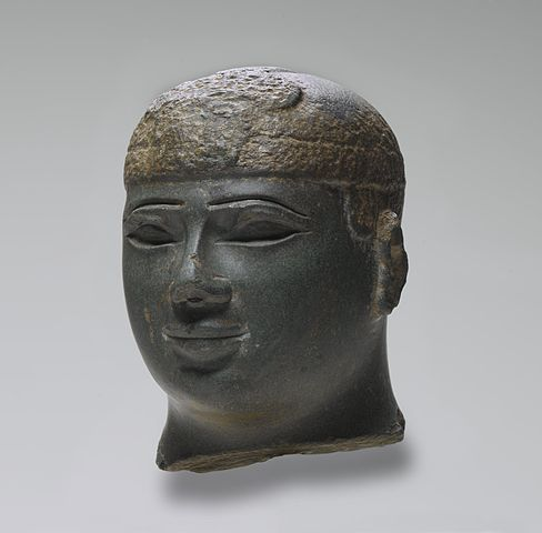 Bust depicts the head of a round-faced ruler with his eyes closed.