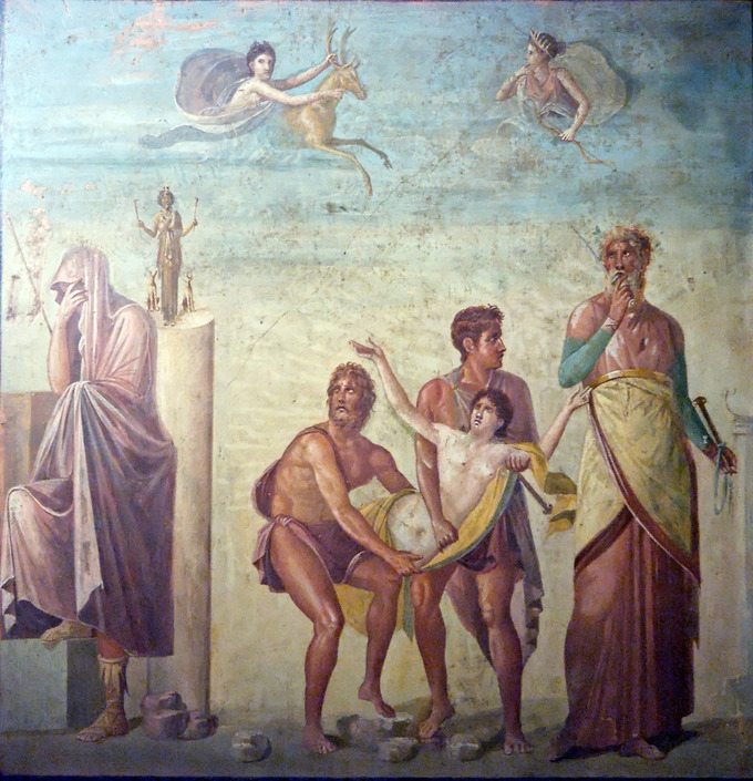 This photo shows the Sacrifice of Iphigenia, a panel in the House of the Tragic Poet. Ulysses and Achilles hold the nude body of Iphigenia between them carrying her to be sacrificed.