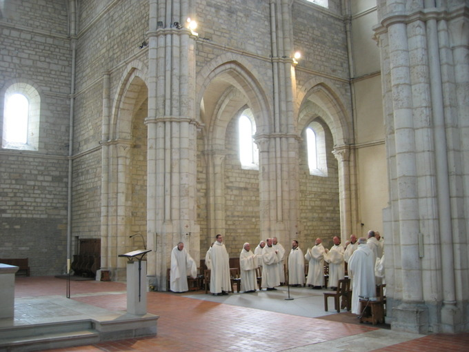 Image of monks gathering inside the Acey Abbey.