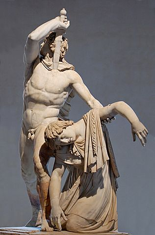 This is a photo of the Ludovisi Gaul statue depicting a man in the act of plunging a sword into his breast, looking backwards defiantly while he supports the dying figure of a woman with his left arm.