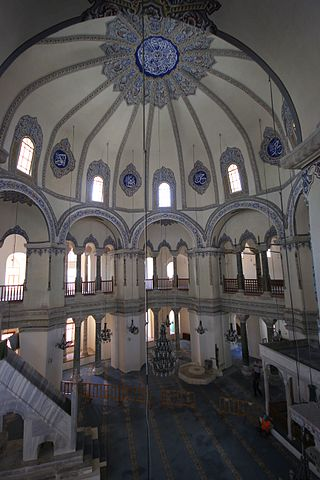 This is a current-day photo of Little Hagia Sophia. It captures the dome decorated with a blue floral stained glass pattern.