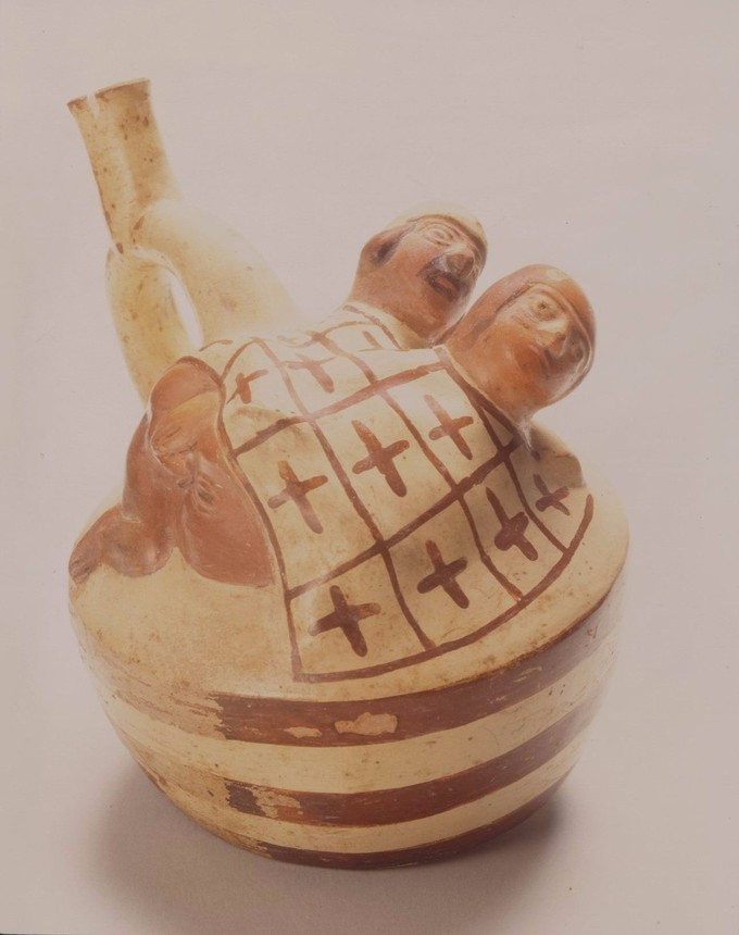 This pot depicts a male and female in a sexual position underneath a blanket.