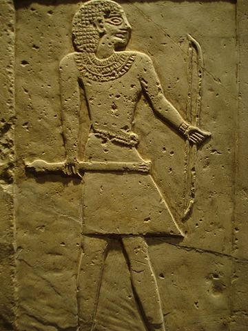Grave stelae with a man in a loincloth carved in relief.