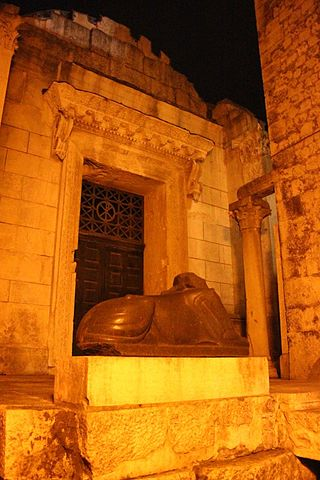 This is a photo of the headless sphinx in front of the Temple of Jupiter.