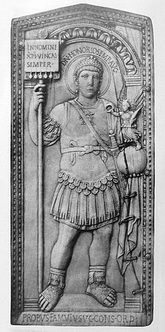 This is a photo of the consular diptych of Probus. In this diptych, Probus is portrayed in elaborate armor and he holds a globe with a Victory on top.