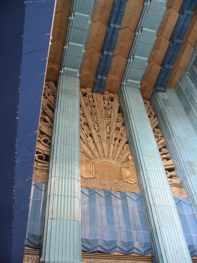This photo shows the Eastern Columbia Building entrance, in Los Angeles, built in 1930. The sunburst design executed in terra cotta exemplifies Art Deco's characteristic combination of craft, ornament, and geometrical motif.