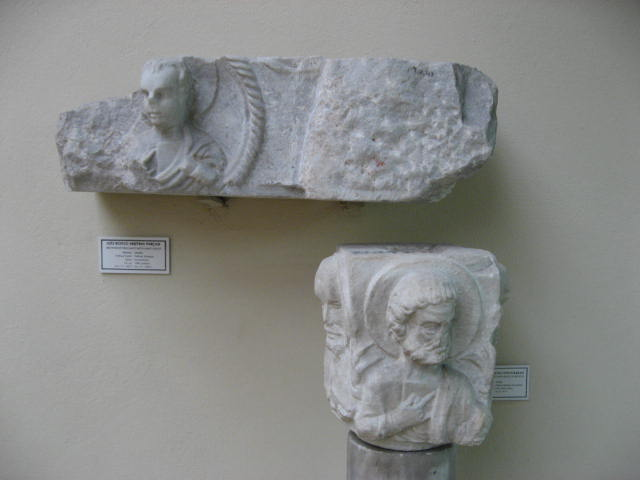 This is a photo of a Column capital that is decorated with busts of apostles.
