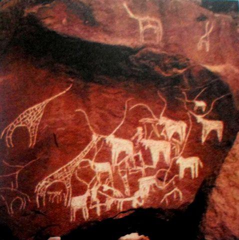 Wall art depicting various grassland animals, including giraffes.