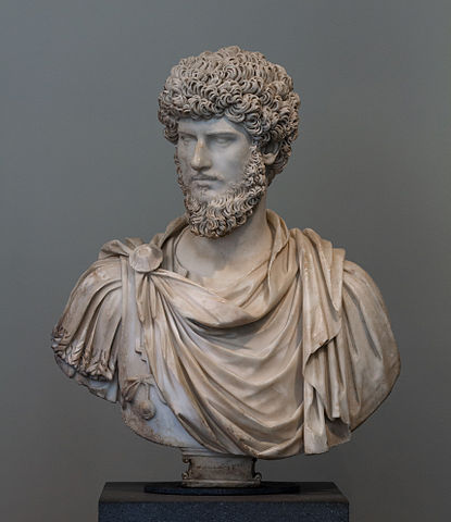 This is a photo of a bust of Lucius Verus, the adopted brother of Marcus Aurelius. He, too, has curly hair and a long, curly beard.