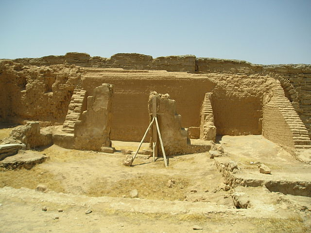 This is a photo of the ruins as they stand today of a house church at Dura-Europos. It shows the chapel area on the right. The ruins are a sandy brown color.