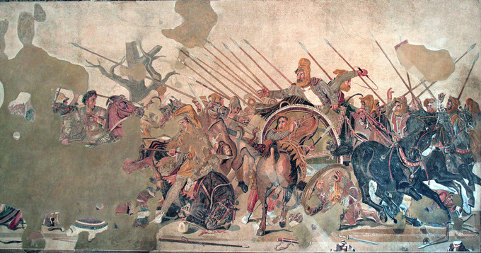 This is a photo of the Alexander Mosaic (Battle of Issus). It depicts a battle scene in which several men on horses raise spears as if charging a target.