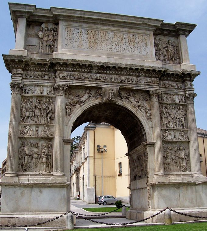 This is a current-day photo of the Arch of Trajan at Benevento. It captures the reliefs described below.