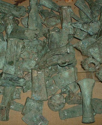 Photo depicts a pile of discarded bronze castings.