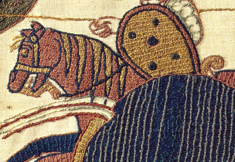 Tapestry image shows a man on a horse.