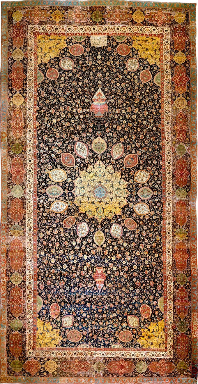 This photo shows the Ardabil Carpet from Persia. Rug with an intricate floral pattern and central medallion.