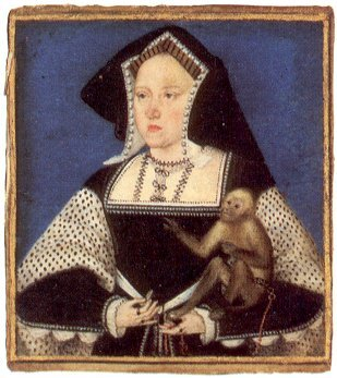 Katharine is wearing black, her gaze slightly to the right, with a monkey sitting on her left arm.