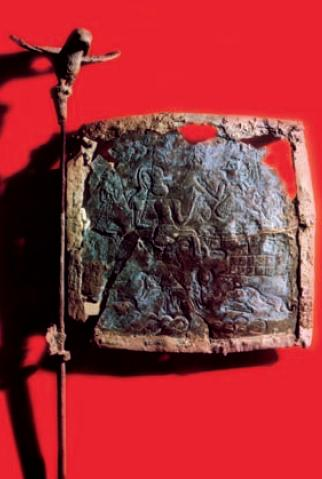 Photo depicts a flag and staff made from bronze.