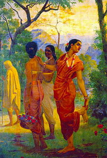 A woman, Shakuntala, dressed in bright red, pretends to remove a thorn from her foot, while actually looking over her shoulder for her husband. Two other women are smiling at each other.