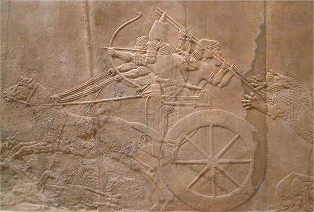 Photograph depicts a stone carving of the king hunting lion from the North Palace, Nineveh seen at the British Museum.
