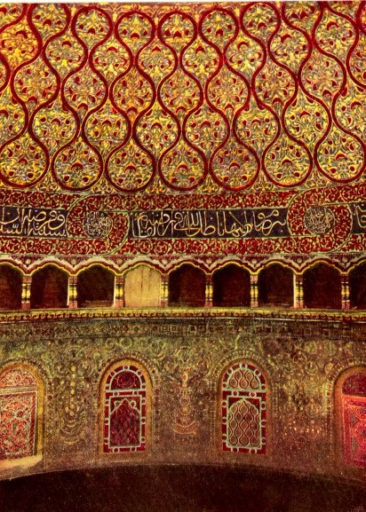 This photo shows the interior view of the Dome of the Rock. The interior of the dome is lavishly decorated in a red and gold color scheme with mosaic, faience and marble, much of which was added several centuries after its completion. It also contains Qur'anic inscriptions