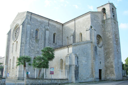 Image of outside of Abbey church of Santa Maria Arabona, Italy. A large, stone building with very little decoration.