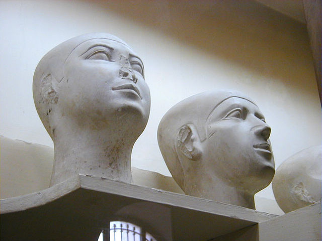 Bust depicts two human heads. They appear to be bald, signaling that they are commoners rather than pharaohs.