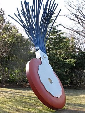 Picture of a large typewriter eraser on display outside.