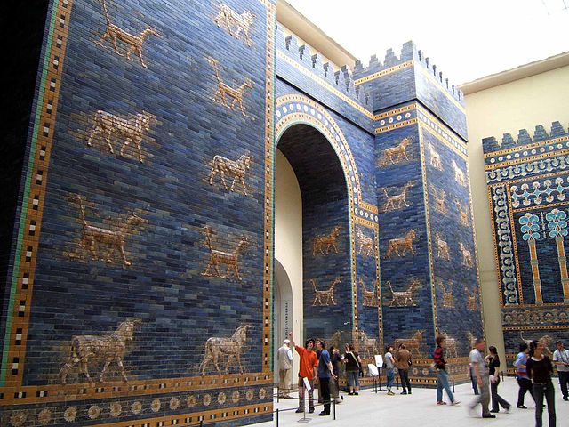 Photo of gate of Ishtar, shows glazed brick with alternating rows of dragons and bulls, symbolizing the gods Marduk and Adad respectively.