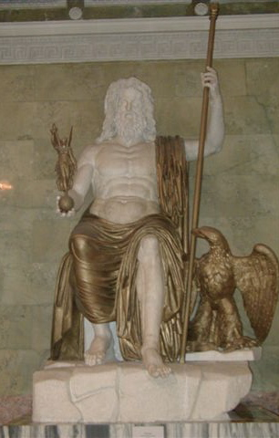 This is a photo of a reconstruction of Phidias' Zeus at Olympia. He is seated, covered from the waist down in a gold draped garment. He holds a gold scepter and has a gold eagle perched at his side.