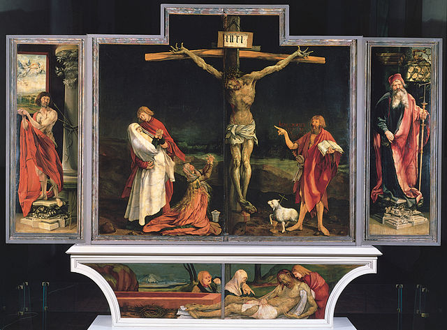 The altarpiece has two sets of wings, displaying three configurations with Jesus on the Cross at the center.